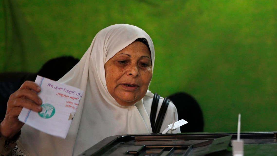 An Egyptian woman casts her ballot at a polling station during the second phase of parliamentary election at a polling station in Cairo, Egypt, Sunday, Nov. 22, 2015. (AP)