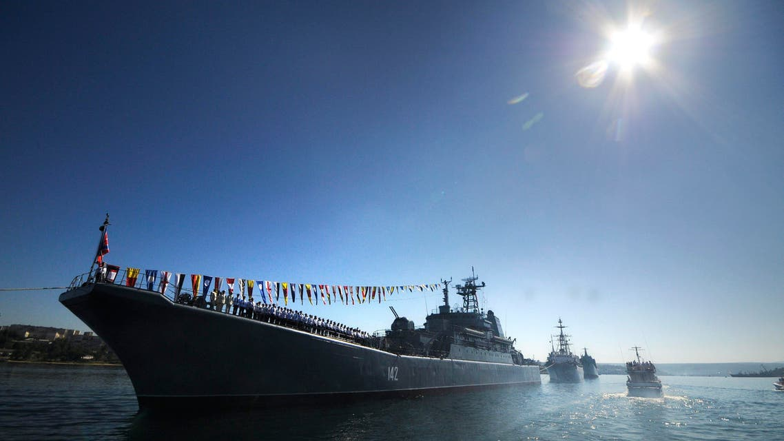 Russian navy battle ships station in the bay during a rehearsal of the Russian Navy Day parade in Sevastopol, Crimea, Friday, July 24, 2015. AP