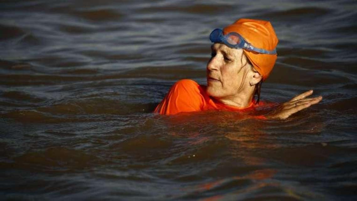 Clad in an bright orange swimsuit bearing the embassy logo, Ambassador Susan Blankhart swam several hundred metres across the Blue Nile
