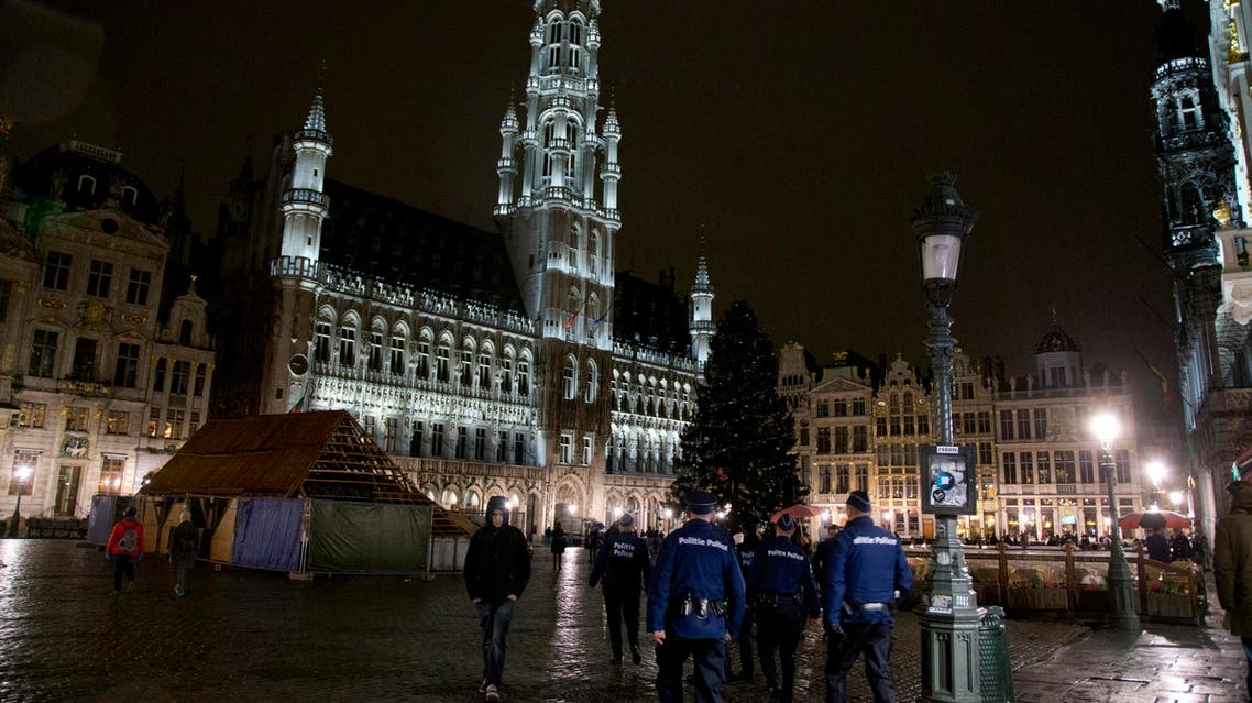 Police patrol in the Grand Place in the center of Brussels on Saturday, Nov. 21, 2015. Belgium raised its security level to the highest degree on Saturday as the manhunt continues for extremist Salah Abdeslam who took part in the Paris attacks. The security alert shut metro's, shops, and cancelled events with high concentrations of people. (AP Photo/Virginia Mayo)