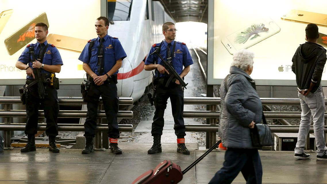 Swiss police officers stand guard at the main railway station in Zurich, Switzerland November 15, 2015.