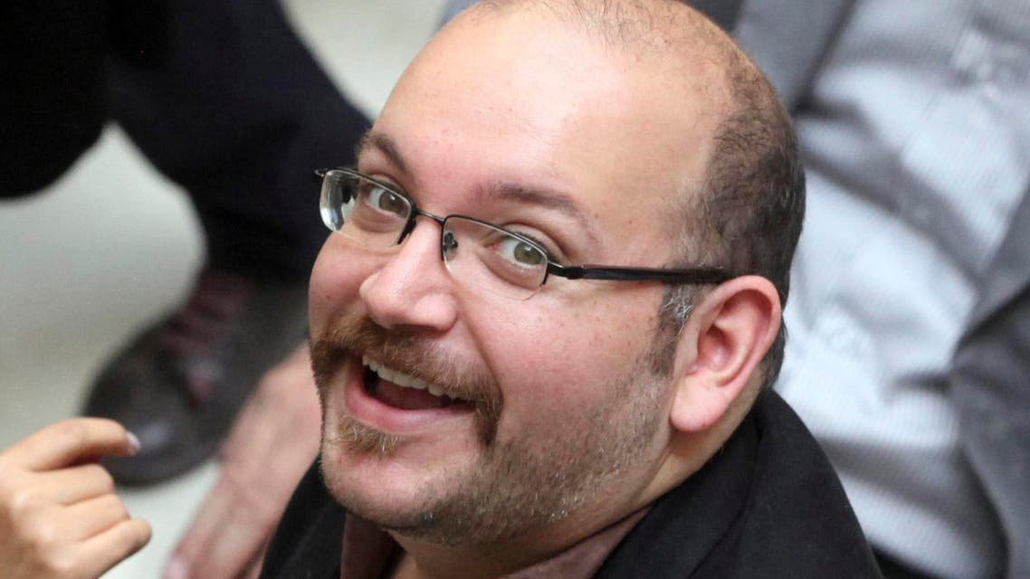 In this photo April 11, 2013 file photo, Jason Rezaian, an Iranian-American correspondent for the Washington Post, smiles as he attends a presidential campaign of President Hassan Rouhani in Tehran, Iran. AP