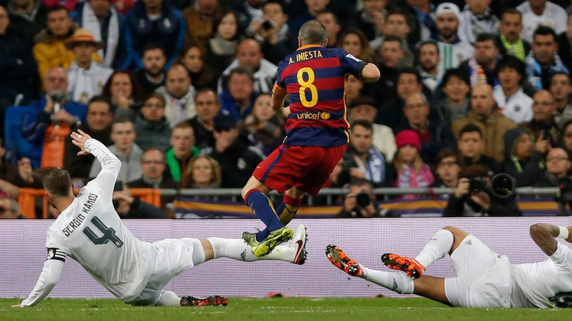 Barcelona's Andres Iniesta scores during the first clasico of the season between Real Madrid and Barcelona at the Santiago Bernabeu stadium in Madrid, Spain, Saturday, Nov. 21, 2015. (AP)