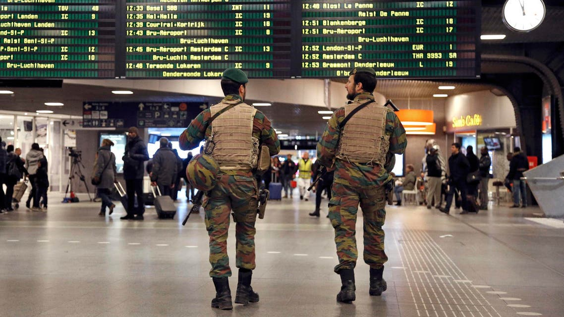 Belgian soldiers patrol in the arrival hall at Midi railway station in Brussels. (Reuters)