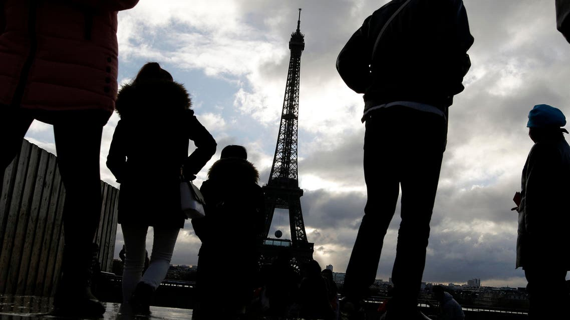 People look at the Eiffel tower from the Trocadero place a week after the start of the Paris attacks, in Paris, Saturday, Nov. 21, 2015 (AP)