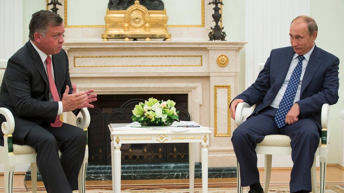 Russian President Vladimir Putin, right, listens to King Abdullah II of Jordan during their meeting in the Kremlin, in Moscow, Russia, Tuesday, Aug. 25, 2015. (AP Photo/Pavel Golovkin, pool)