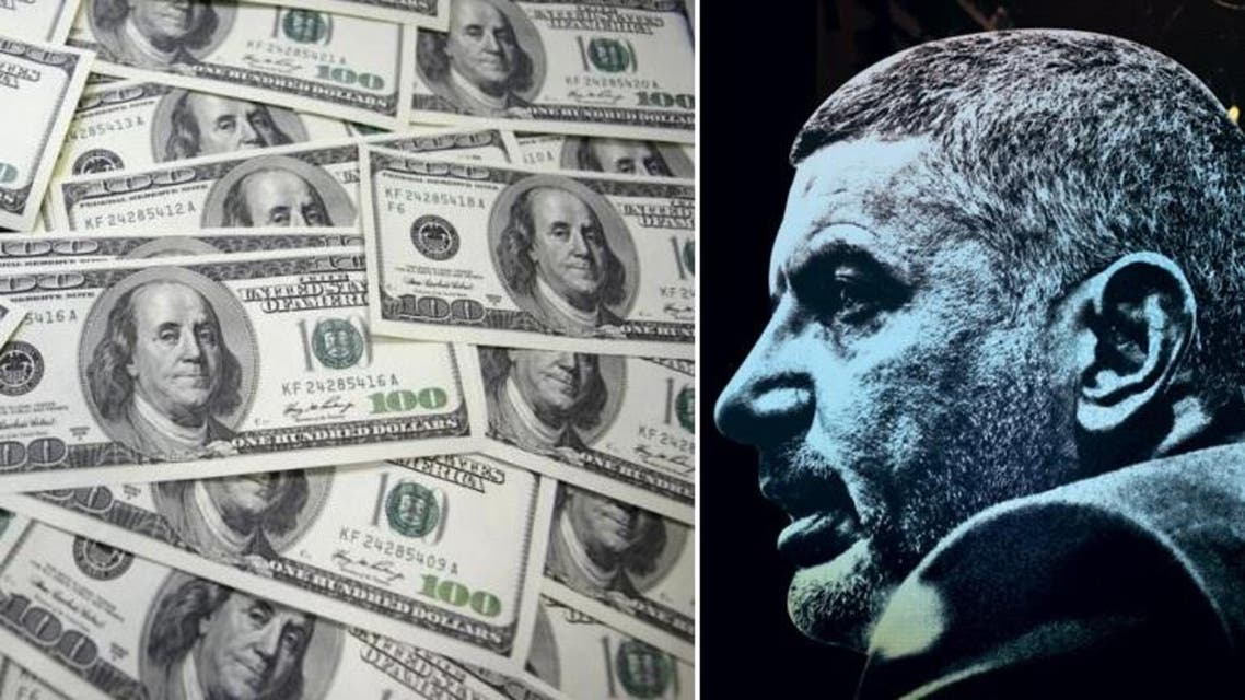 A poster image shows business tycoon Hassan Malek. (Photos courtesy: Shawn Baldwin and Reuters)
