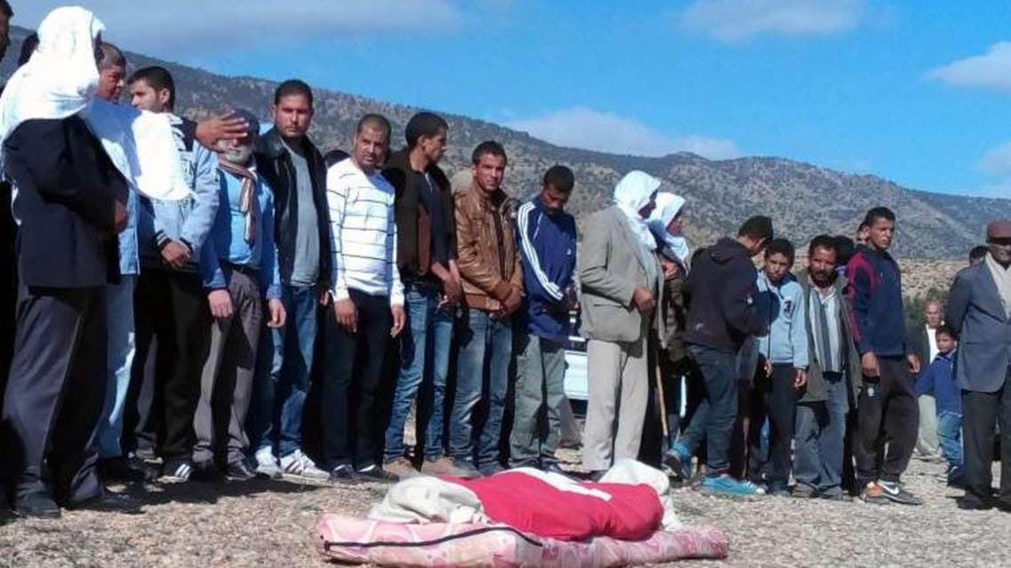 Tunisians praying before the burial of 16-year-old shepherd, Mabrouk Soltani, who was beheaded by jihadists. PHOTO: AFP