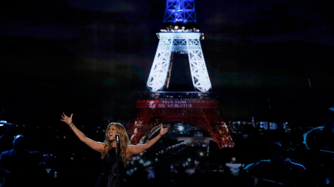 """Celine Dion performs """"Hymne ? l'amour"""" in honor of the victims of the recent Paris attacks as an image of the Eiffel Tower is shown in the background during the 2015 American Music Awards in Los Angeles, California November 22, 2015."""