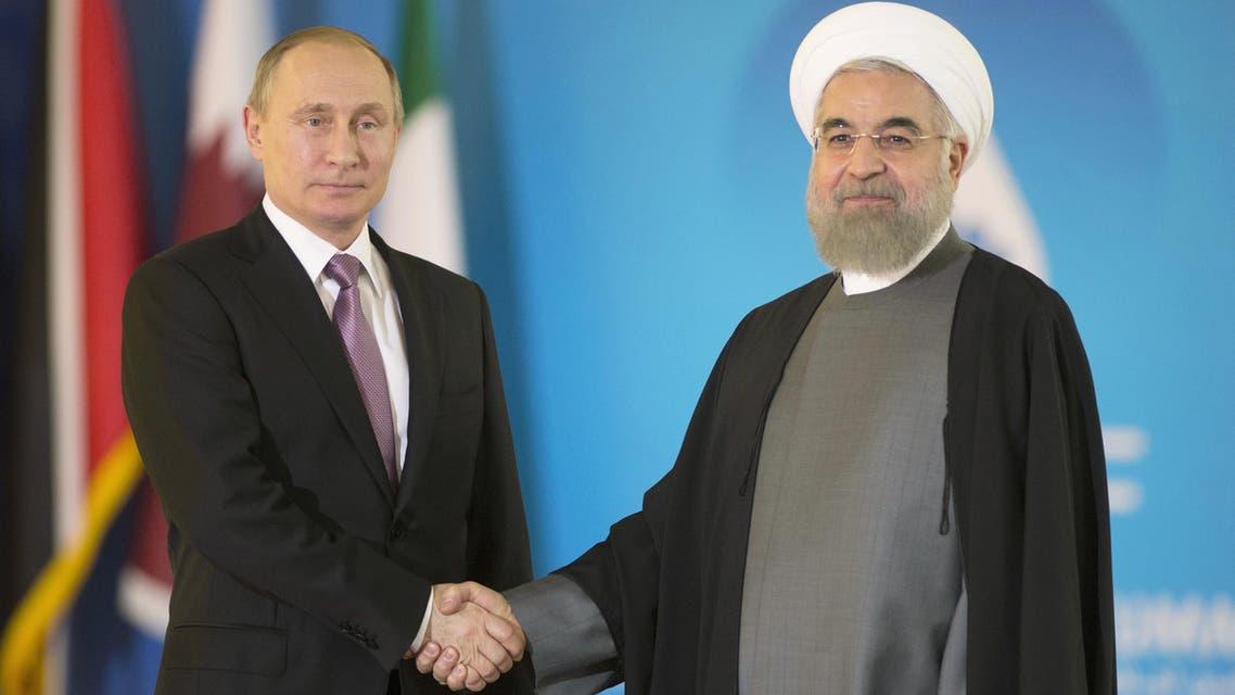 Iran President Hassan Rouhani, right, shakes hands with Russian President Vladimir Putin prior to attending the Gas Exporting Countries Forum, GECF, summit meeting in Tehran, Iran, Monday, Nov. 23, 2015. (Sergei Guneyev/Sputnik, Kremlin Pool Photo via AP)