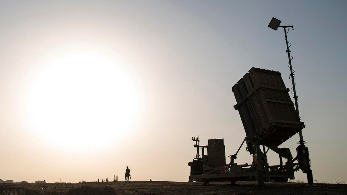 An Israeli soldier walks next to an Iron Dome rocket defense battery near the southern city of Sderot, Israel. (AP)