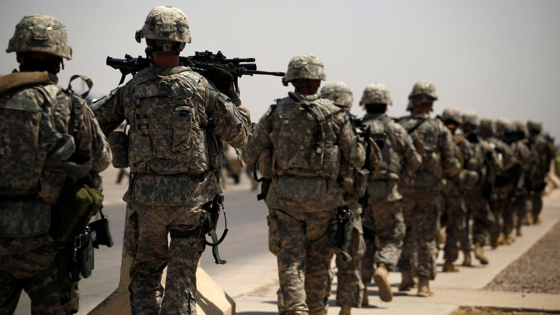 In this Tuesday, Aug. 2, 2011 photo, U.S. Army soldiers make their way to a C-130 aircraft at Sather Air Base in Baghdad, Iraq to begin their journey home to the United States.