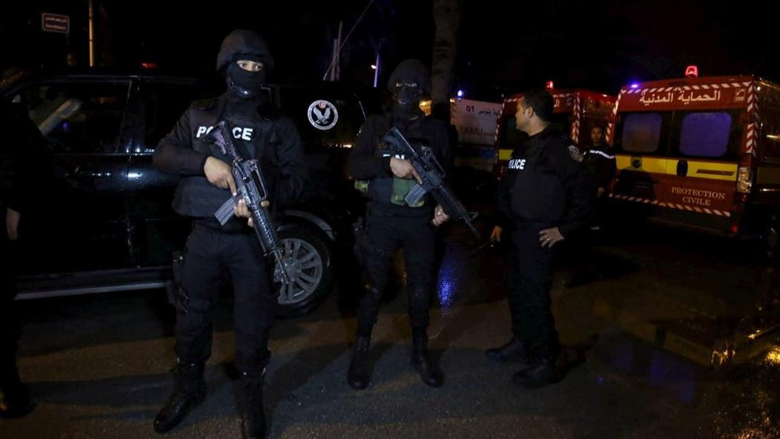 Tunisian police officers are pictured after an attack on a military bus in Tunis, Tunisia November 24, 2015. (Reuetrs)