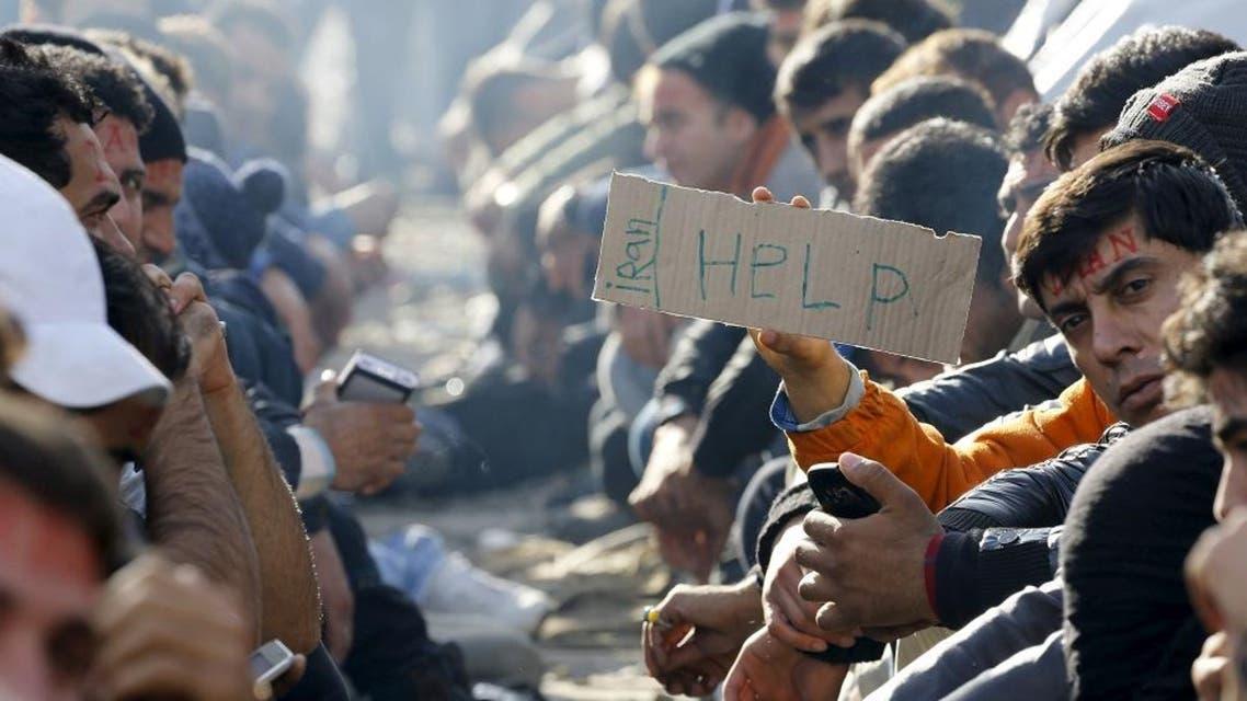 Stranded Iranian migrants sit on rail tracks at the border between Greece and Macedonia near the Greek village of Idomeni November 24, 2015. (Reuters)