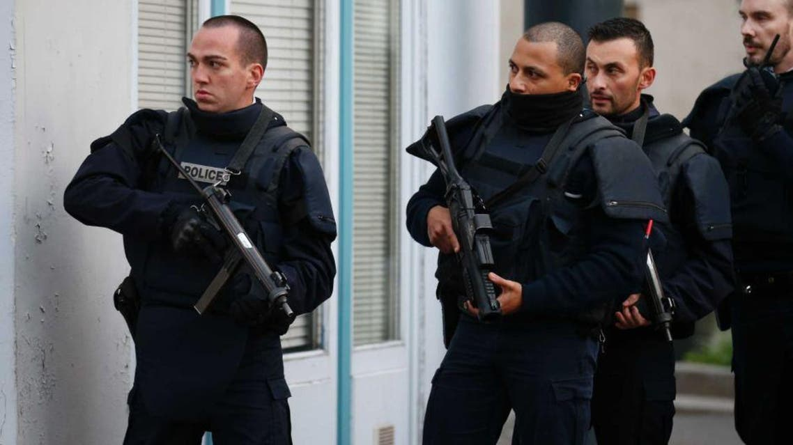 French police secure the area as shots are exchanged in Saint-Denis, France, near Paris, November 18, 2015 during an operation to catch fugitives from Friday night's deadly attacks in the French capital. | Reuters