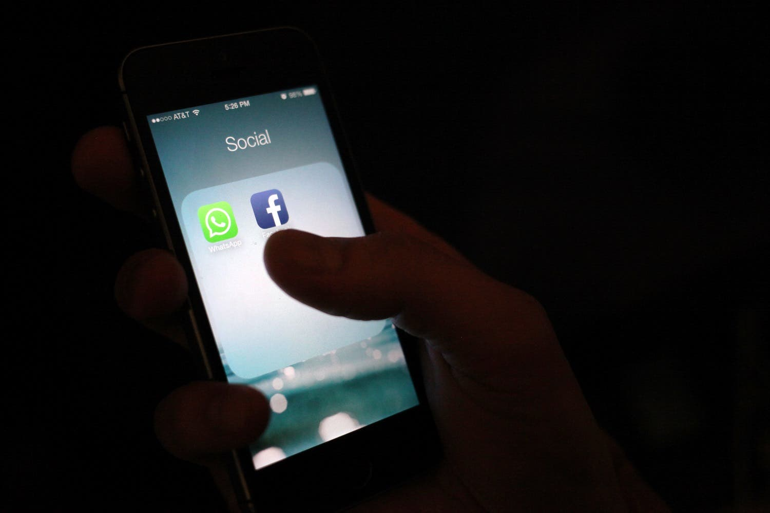 WhatsApp and Facebook app icons on an iPhone. (File photo: AP)