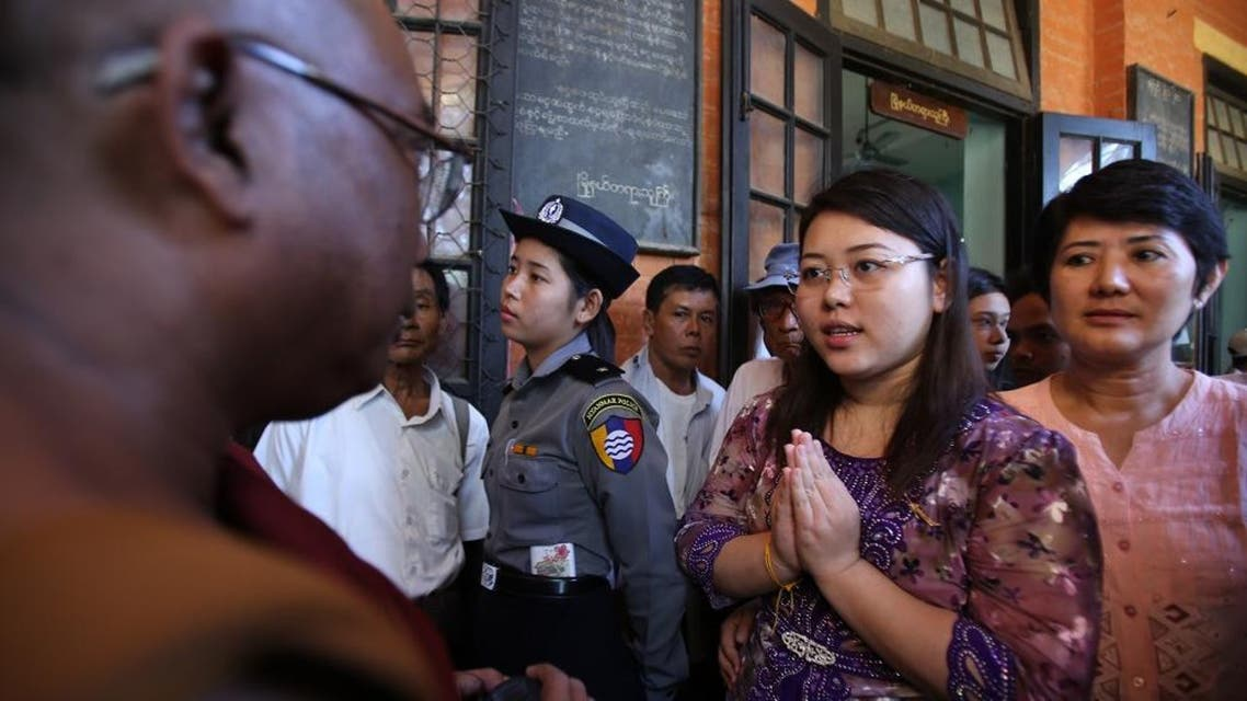 Student Chaw Sandi Tun, 25, speaks with a Buddhist monk after her hearing at court in Maubin, Myanmar, Tuesday, Nov. 24, 2015. Chaw returned to court Tuesday for poking fun at Myanmar's commander-in-chief on Facebook, highlighting the challenges faced by the country's former military rulers as they grapple with a social media explosion, street protests other newfound freedoms of expression. (AP Photo/Hau Dinh)
