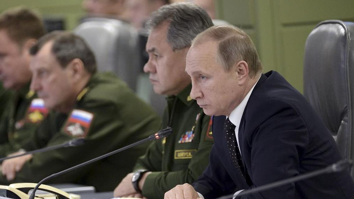 Russian President Vladimir Putin (R) with Defence Minister Sergei Shoigu (C) attend a meeting on Russian air force's activity in Syria. (Reuters)