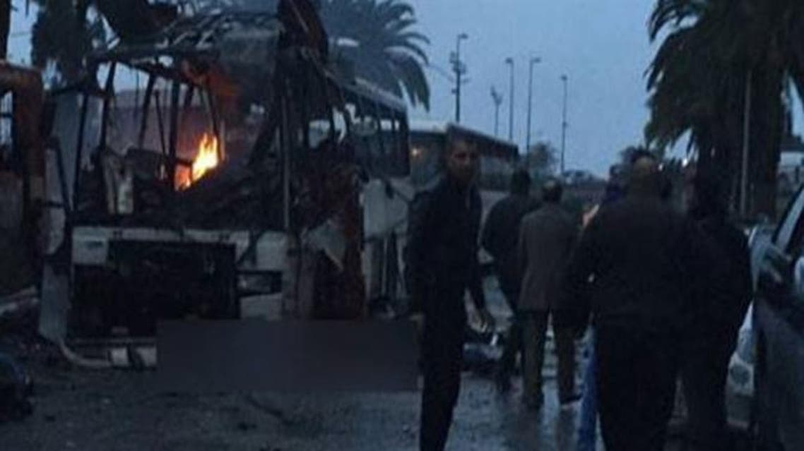 Tunis tunisia bus explosion Early photographs showed a torched bus surrounded by onlookers. (Photo courtesy: businessnews.com.tn)