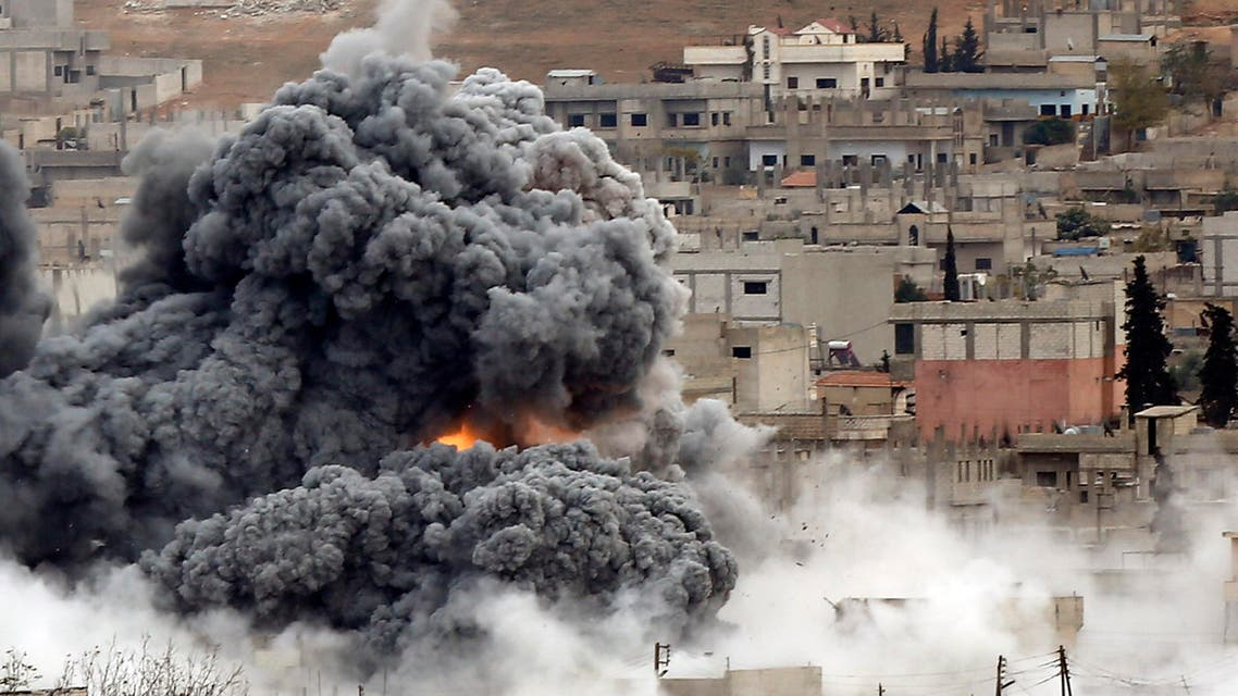 Smoke and flames rise over a hill near the Syrian town of Kobane after an airstrike last year. (Reuters)