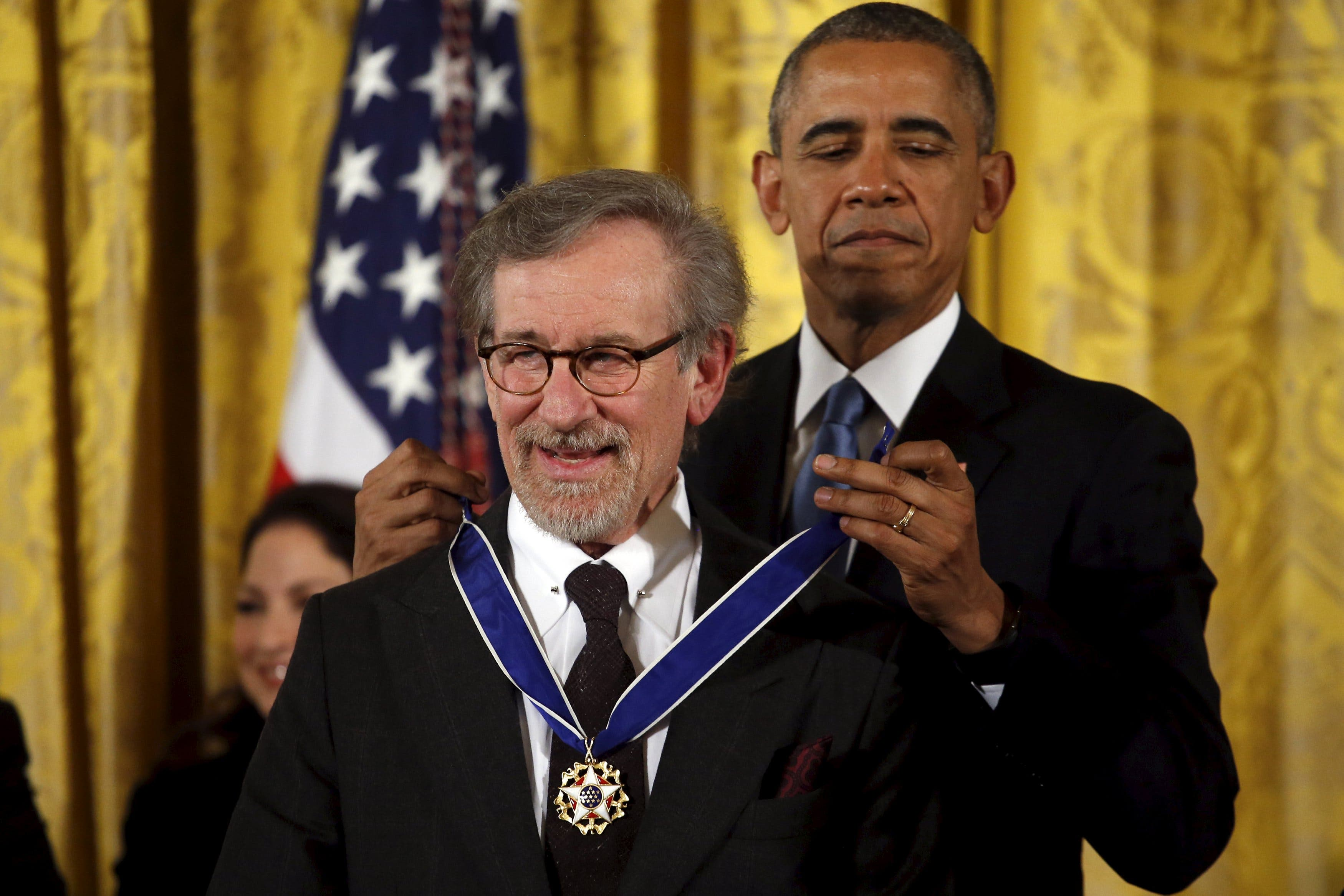 U.S. President Barack Obama presents the Presidential Medal of Freedom to film director Steven Spielberg during an event in the East Room of the White House in Washington. (Reuters)