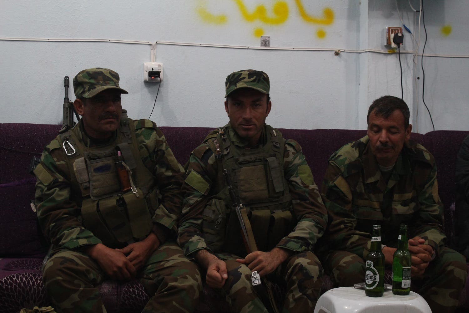 Yazidi fighters relax after battle. For them, the war goes on. (Florian Neuho/Al Arabiya News)