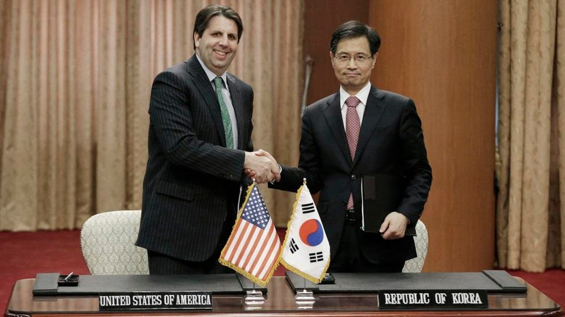South Korean Ambassador for Nuclear Energy Cooperation Park Ro-byug, right, shakes hands with U.S. Ambassador to South Korea Mark Lippert during a signing ceremony for their nuclear agreement at the Foreign Ministry in Seoul, South Korea Wednesday, April 22, 2015 | AP