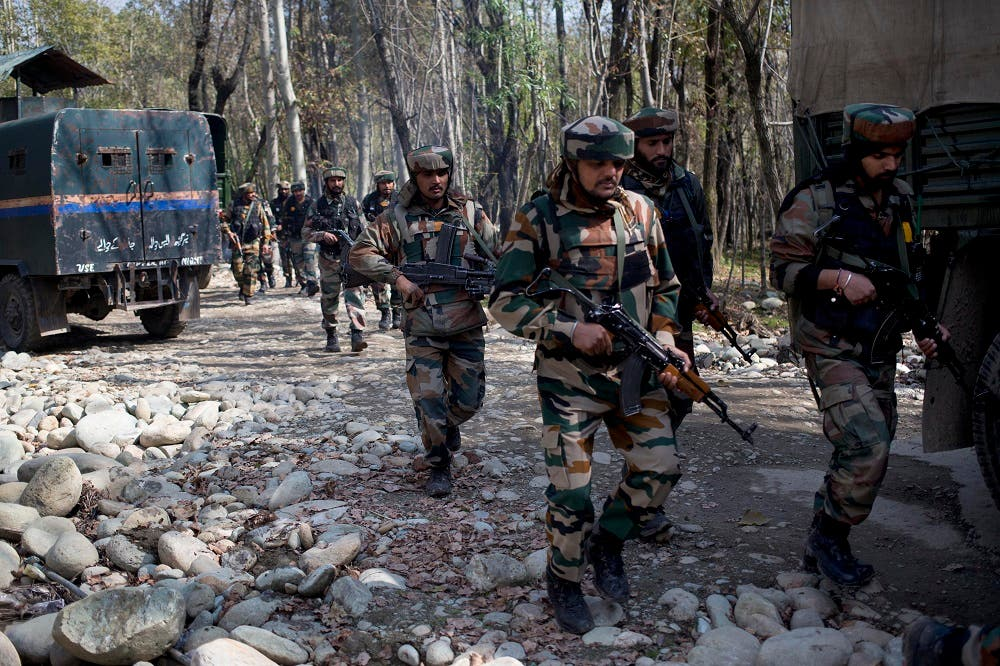 Indian army soldiers patrol near the site of a gunbattle with suspected rebels in Bungham village, northwest of Srinagar, Indian controlled Kashmir, Wednesday, Oct. 21, 2015 | AP