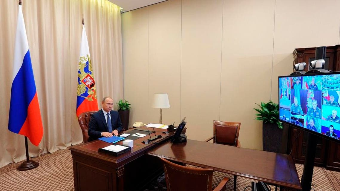 Russian President Vladimir Putin holds a video conference with the top military brass on a Russian air campaign in Syria, in the Novo-Ogaryovo residence outside Moscow, Russia, Friday, Nov. 20, 2015 | Reuters