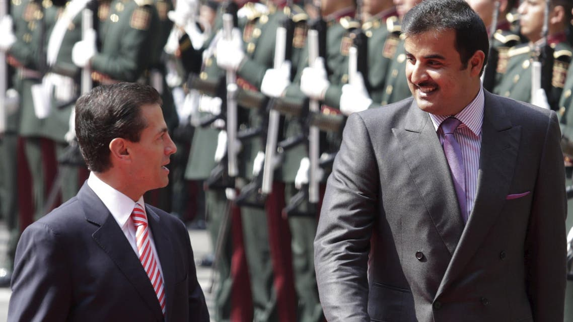 Mexico's President Enrique Pena Nieto and Qatar's Emir Sheikh Tamim Bin Hamad Al-Thani review the honour guard during an official welcoming ceremony for al-Thani, in Mexico City. (Reuters)