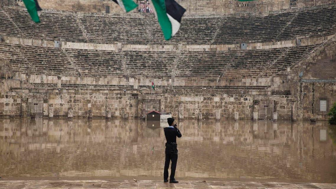 A Jordanian policeman inspects the flooded ancient Roman theatre in downtown Amman, Jordan. (File photo: AP)