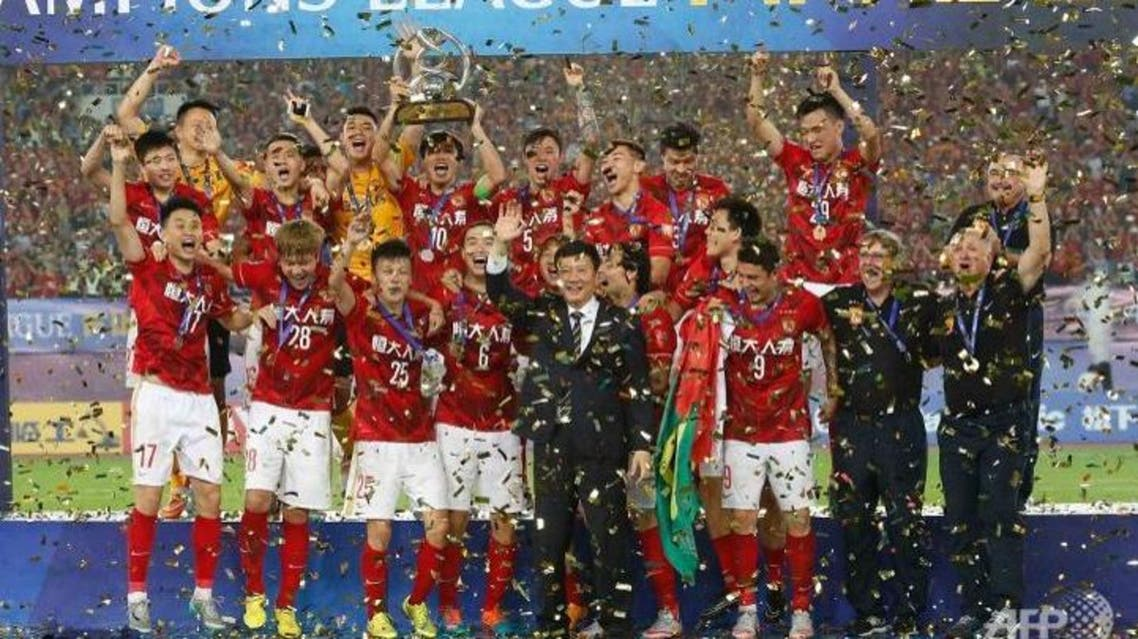 China's Guangzhou Evergrande celebrate their win in the AFC Champions League football final against UAE's Al Ahli in Guangzhou