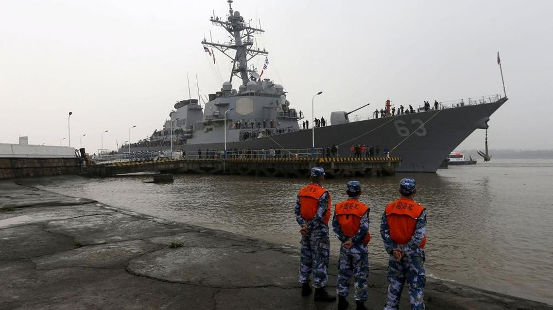 Chinese People's Liberation Army (PLA) navy soldiers stand guard as USS Stethem (DDG 63) destroyer vessel arrives at a military port for an official visit, in Shanghai, China, November 16, 2015 | Reuters