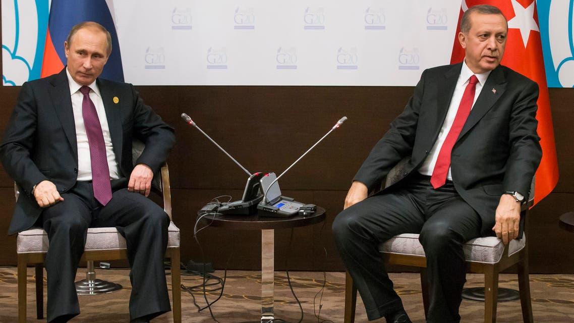 In this file photo taken on Monday, Nov. 16, 2015, Russian President Vladimir Putin, left, and Turkish President Recep Tayyip Erdogan pose for the media before their talks during the G-20 Summit in Antalya, Turkey.