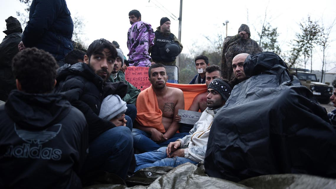 Refugees sew lips together in protest