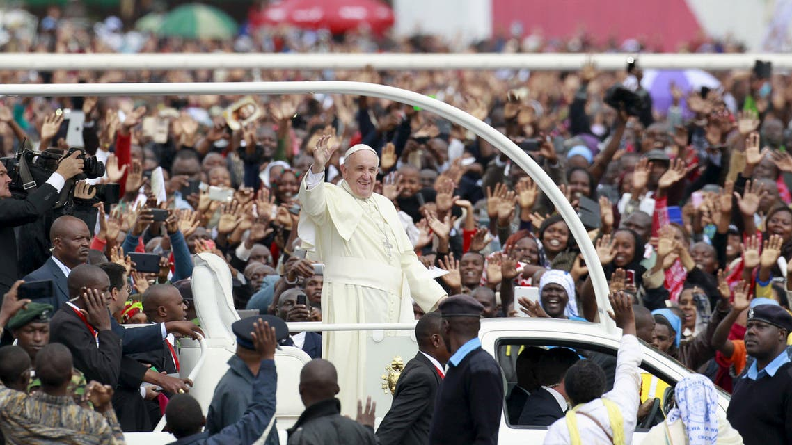 Pope Francis waves to faithful as he arrives for a Papal mass in Kenya's capital Nairobi, November 26, 2015.