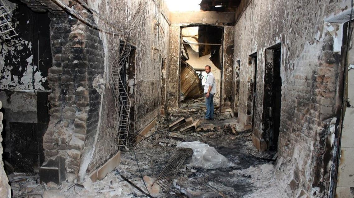 An employee of Doctors Without Borders stands inside the charred remains of their hospital after it was hit by a U.S. airstrike in Kunduz, Afghanistan, Friday, Oct. 16, 2015 (AP)