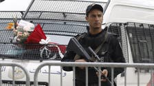 Tunisia condemns eight to death for presidential guard attack