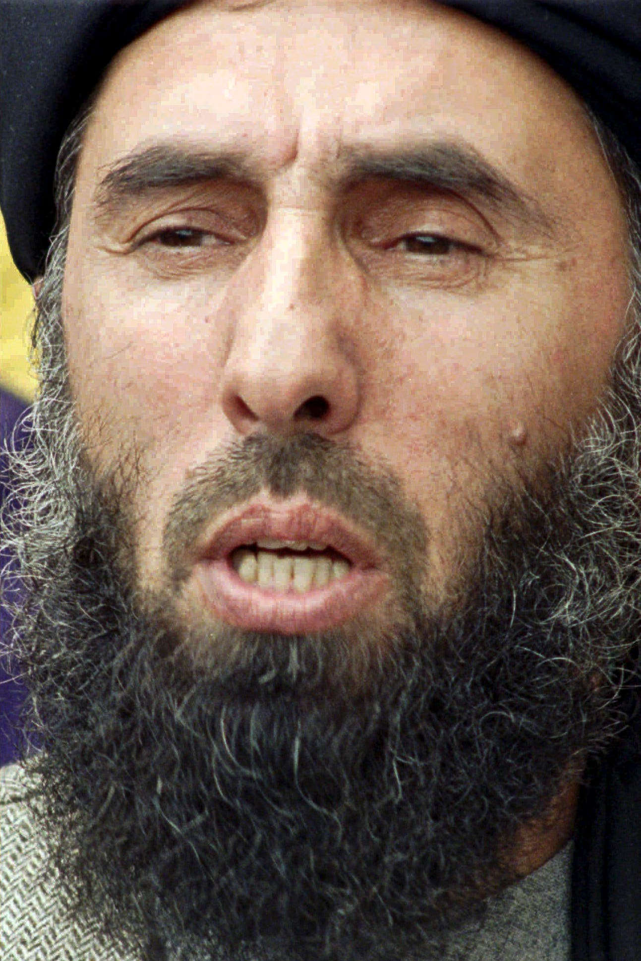 This Feb. 13, 1996, file photo shows Gulbuddin Hekmatyar, Afghan rebel leader and chief of the insurgent group Hezb-e-Islami Gulbuddin, speaking at a news conference in Islamabad, Pakistan.