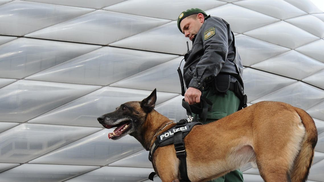 A police officer with his dog