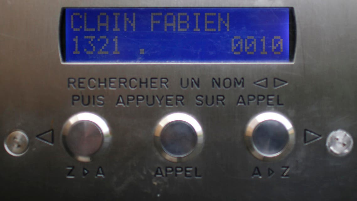 """A name reading """"Clain Fabien"""" is seen on the interphone at the entrance of an apartment building where Fabien Clain grew up in Alencon"""