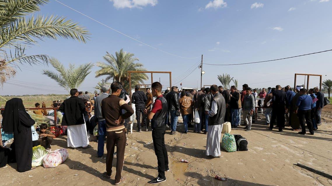 مدنيون يهربون من القصف في الأنبار وينزحون لبغداد (أرشيفية) بغداد العراق نزوح نازحون نازحين