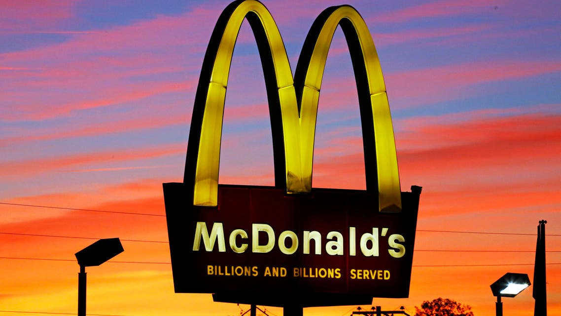 In this Saturday, Oct. 10, 2015, photo, the sun sets behind a McDonald's in Ebensburg, Pa. McDonald's hopes it has a catchy, new deal that will be as hugely popular as its Dollar Menu.