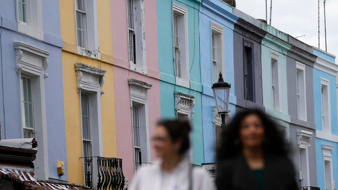 Pedestrians walk past a row of houses in London, Britain June 3, 2015. (Reuters)