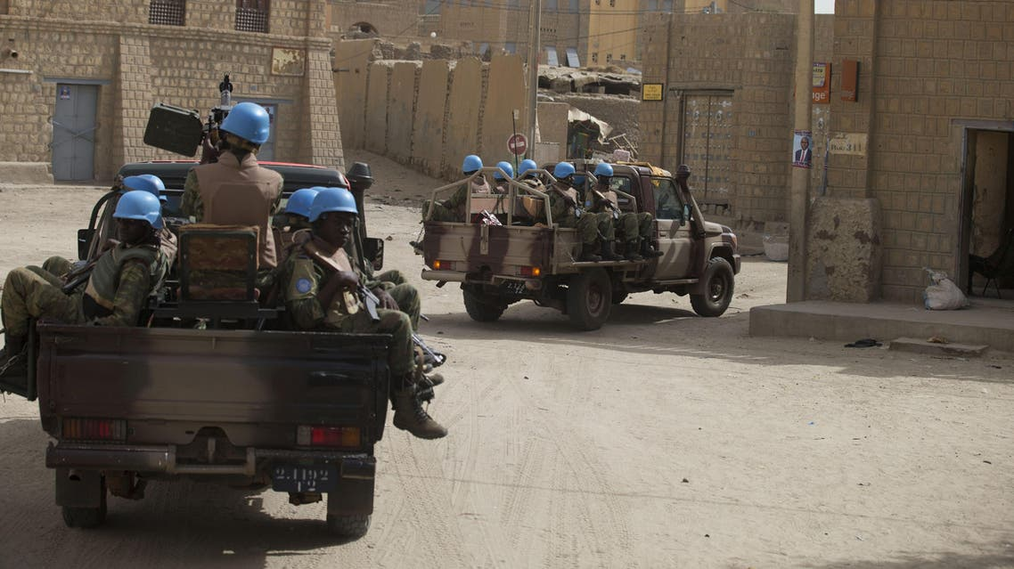 United Nations peacekeepers from Burkina Faso patrol through Timbuktu, Mali, Tuesday, July 23, 2013.