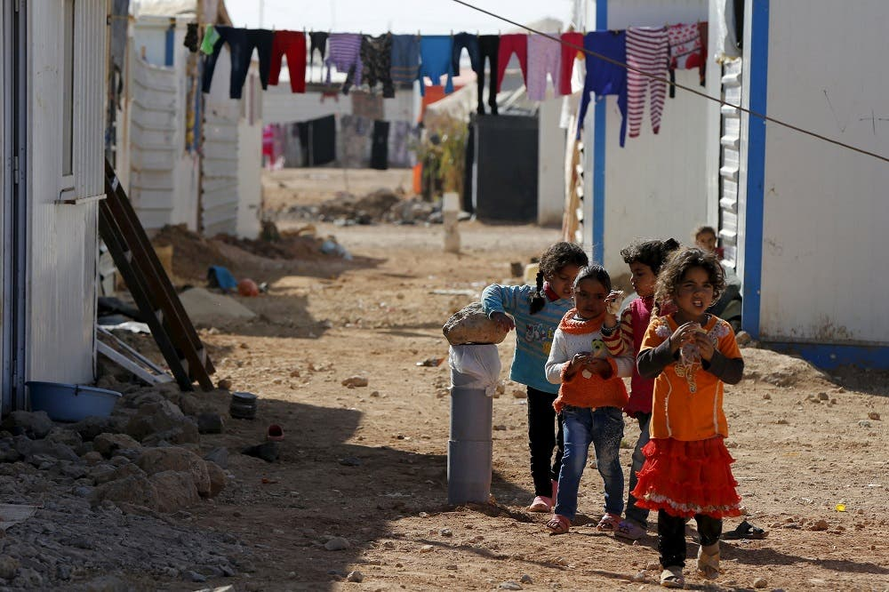 Syrian refugee children play near their families residence at Al Zaatari refugee camp, in the Jordanian city of Mafraq, near the border with Syria, November 29, 2015. REUTERS/ Muhammad Hamed