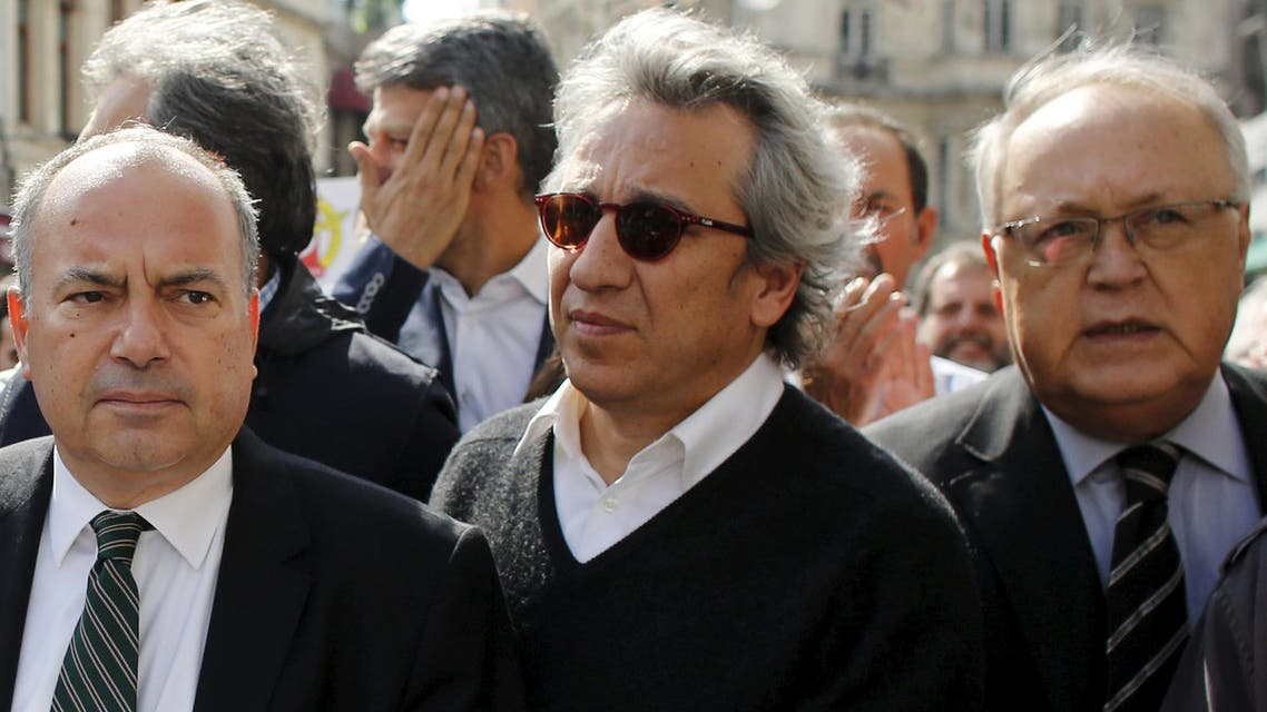 Can Dundar, editor-in-chief of the Cumhuriyet newspaper (C), is seen during a press freedom march in central Istanbul, Turkey, October 3, 2015.