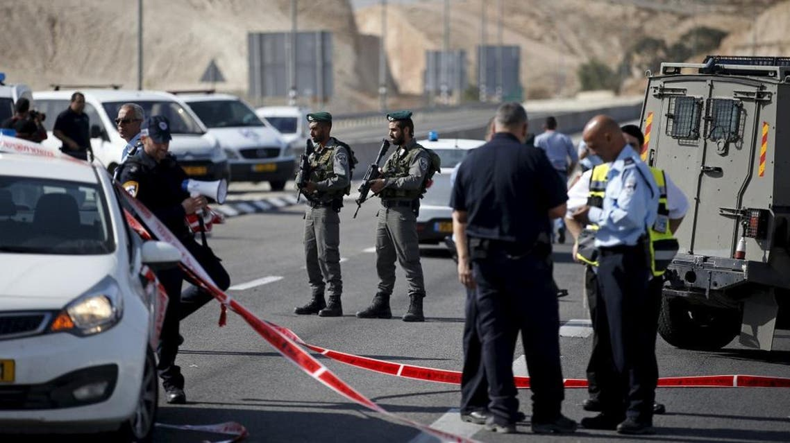 Israeli paramilitary police officers stand guard at the scene of what police said was an attempted ramming attack near the West Bank Jewish settlement of Kfar Adumim November 22, 2015   Reuters