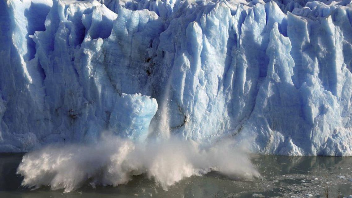 Splinters of ice peel off from one of the sides of the Perito Moreno glacier in a process of a unexpected rupture