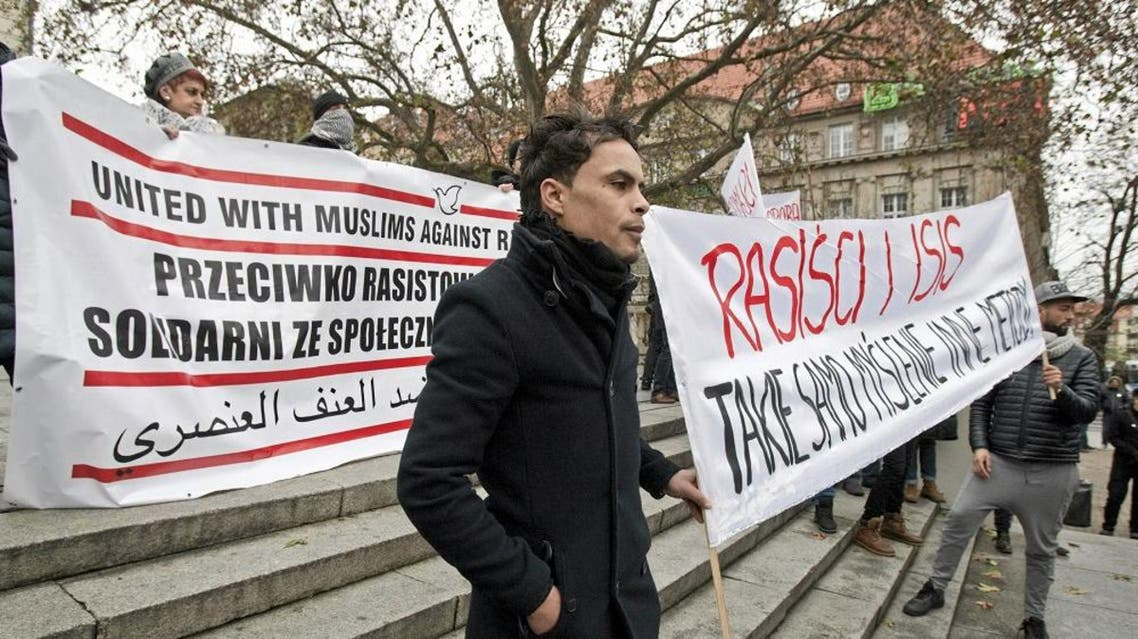 People hold banners during a demonstration of members of Muslim community and groups fighting discrimination against Muslims after the Paris attacks, in Poznan, Poland November 29, 2015.   Reuters